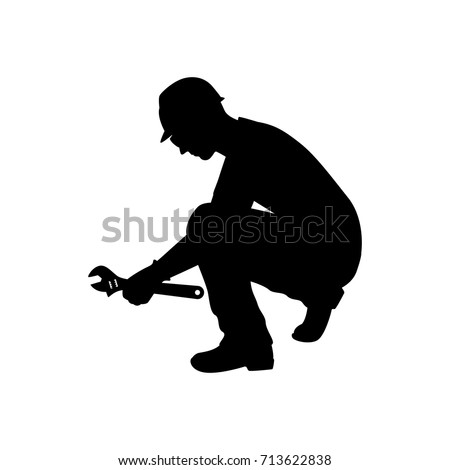 Vector silhouette of a technician with wrench. Isolated vector on white background.