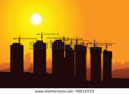 Vector silhouette of cranes on sunset