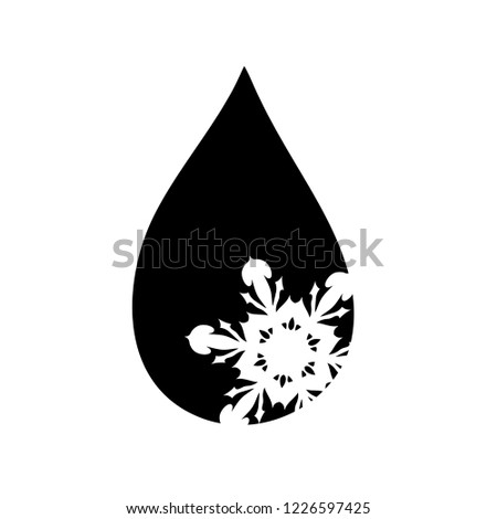 Vector silhouette of drop with snowflake.