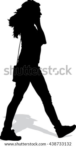 Vector silhouette of the walking girl with a handbag and mobile phone