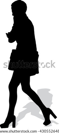 Vector silhouette of the walking girl with phone