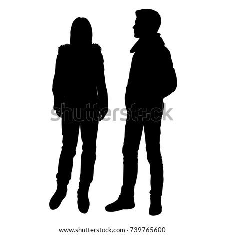 Vector silhouettes of man and woman standing, couple, outerwear, black color, isolated on white background