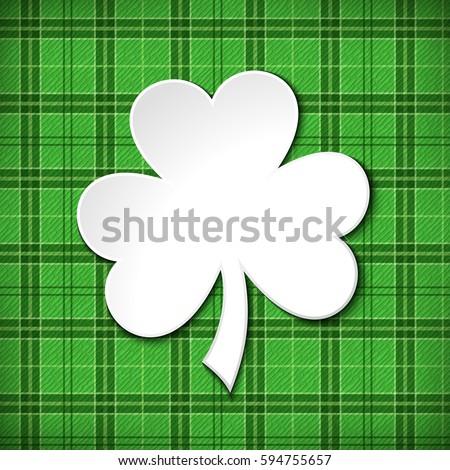 Vector St. Patrick's day green tartan card with shamrock.