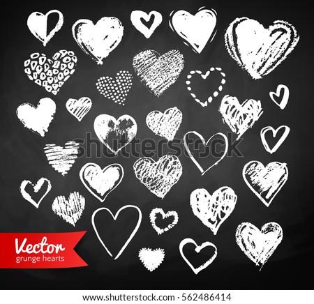 Vector white chalk drawn collection of grunge Valentine hearts on blackboard background.