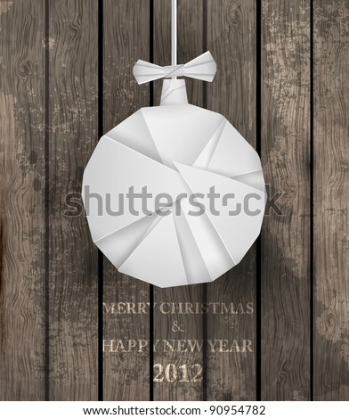 Vector white paper christmas origami ball on a wood background