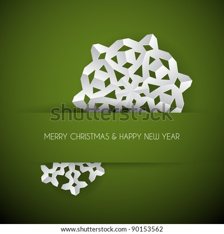 Vector white paper christmas snowflake on a green background