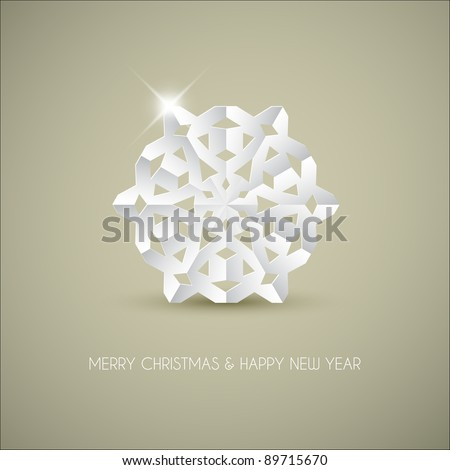 Vector white paper christmas snowflake on a light brown background