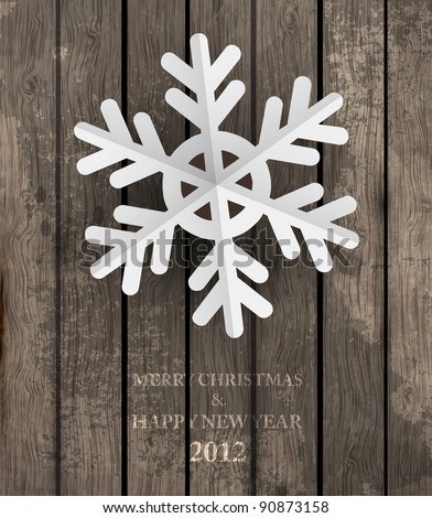 Vector white paper christmas snowflake on a wood background