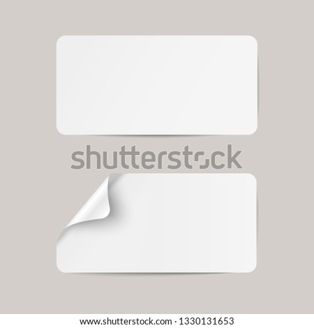Vector white realistic paper adhesive stickers with curved left corner on transparent background. #1330131653