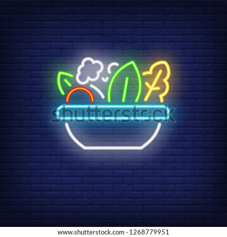 Vegetable salad neon sign. Glowing bowl with vegetables on brick wall background. Vector illustration can be used for topics like cooking, dinner, kitchen, vegetarian