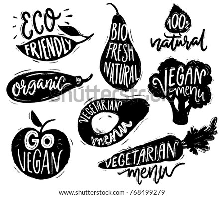 Vegetarian menu badges and stickers for cafe and restaurants. Vegan text on black vegetable labels for natural products. Broccoli, avocado, carrot hand drawn silhouettes with lettering