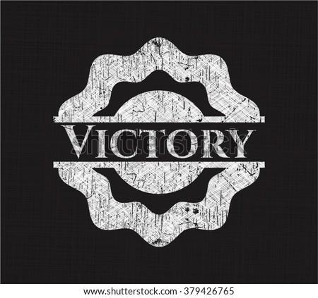 Victory chalkboard emblem written on a blackboard
