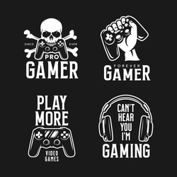 Video games related t-shirt set. Monochrome design elements with texts. Pro Gamer. Play More quotes. Skull with bones hand holding joystick. Vector vintage illustration.