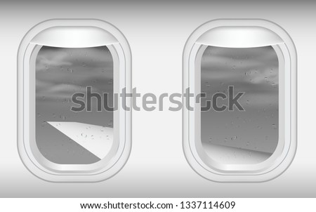 view of windows of plane in on the sky in the rain
