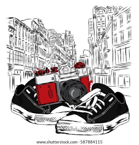 vintage camera and sneakers on