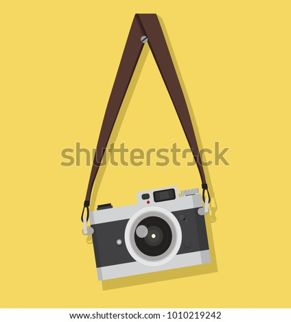 vintage camera hanging on a screw