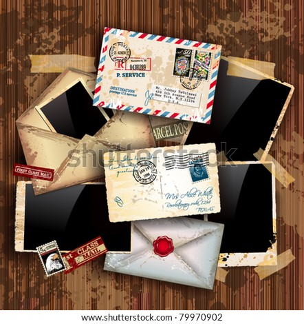 Vintage composition with old style distressed postage design elements and antique photo frames plus some post stickers. Background is wood.