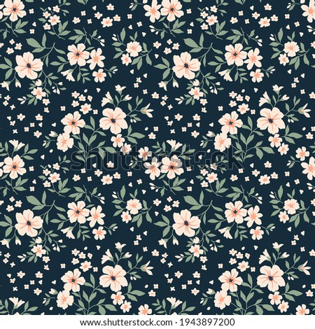 Vintage floral background. Floral pattern with small white flowers on a dark blue background. Seamless pattern for design and fashion prints. Ditsy style. Stock vector illustration.