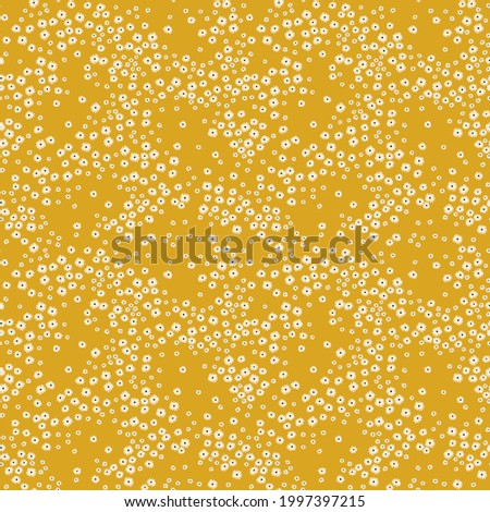 Vintage floral background. Floral pattern with small white flowers on a yellow gold background. Seamless pattern for design and fashion prints. Ditsy style. Stock vector illustration.