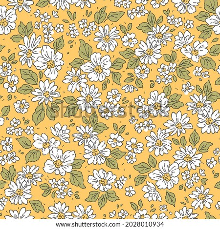 Vintage floral background. Floral pattern with small white flowers on a yellow mustard background. Seamless pattern for design and fashion prints. Ditsy style. Stock vector illustration.