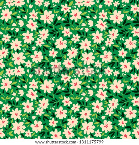 Vintage floral background. Seamless vector pattern for design and fashion prints. Flowers pattern with small white flowers on a green background. Ditsy style.