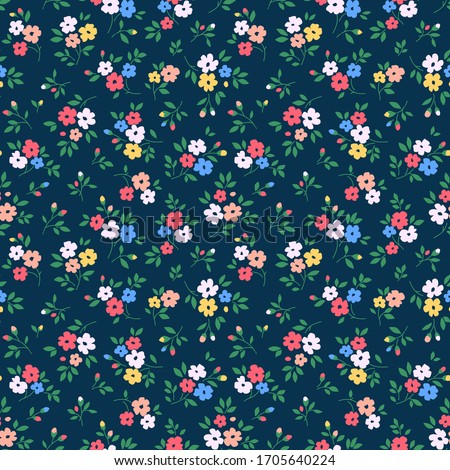 Vintage floral background. Seamless vector pattern for design and fashion prints. Flowers pattern with small colorful flowers on a navy blue background. Ditsy style.