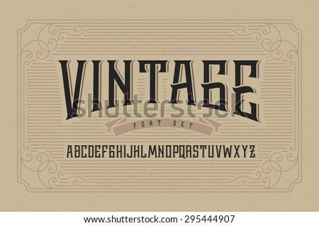 Vintage font set on cardboard texture vector background with decorative ornate frame.