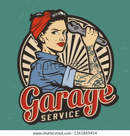 Vintage garage service emblem with pin up pretty girl with in bandana and tattoo on arm holding wrench isolated vector illustration Stock fotó ©