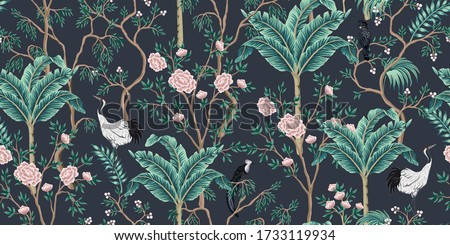 Vintage garden tree, banana tree, birds, crane floral seamless pattern black background. Exotic chinoiserie wallpaper.