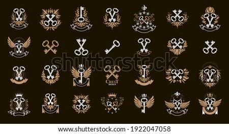 Vintage keys vector logos or emblems, heraldic design elements big set, classic style heraldry turnkeys symbols, antique secrets and locks. ストックフォト ©