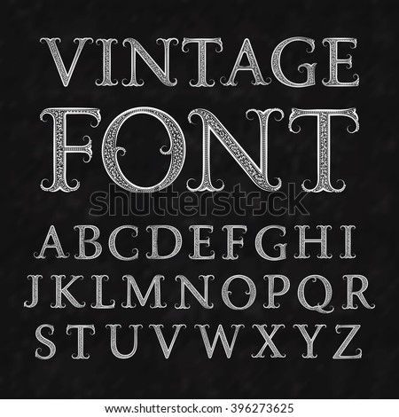 Vintage patterned letters. Vintage font in floral baroque style. Vintage latin alphabet. Vintage white capital letters on a black textured background.