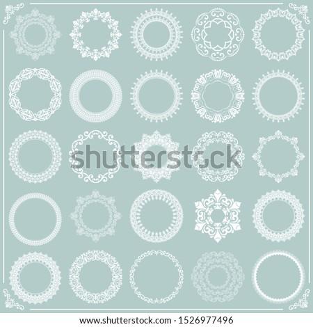 Vintage set of vector round white elements. Different elements for design frames, cards, menus, backgrounds and monograms. Classic patterns. Set of vintage patterns