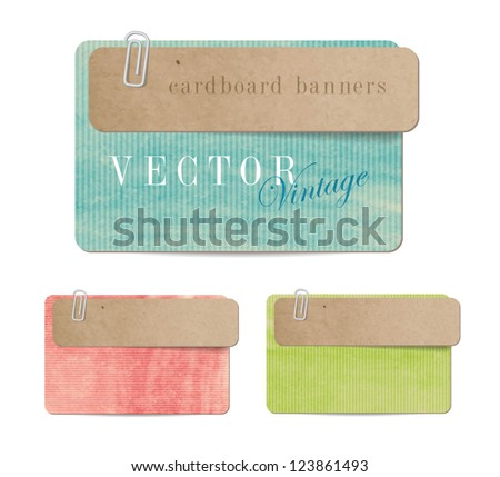 Vintage style paper banners with cardboard tags attached with paper clips