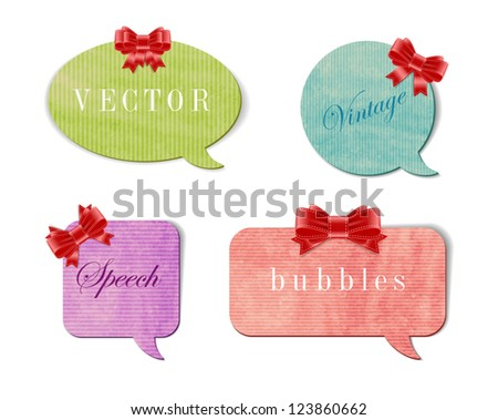 Vintage style textured colored paper cardboard speech bubbles with silky bow knots