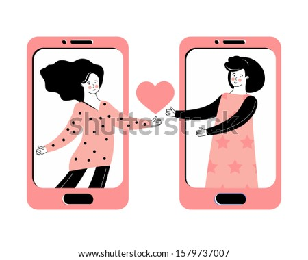 Virtual relationships, online dating and social networking. LGBT concept. Romantic relationship between a two women. Сhatting on the Internet. Love message through the mobile app. Lesbian couple.