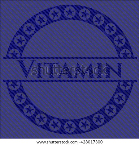 Vitamin badge with denim background