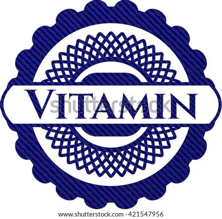 Vitamin badge with denim texture