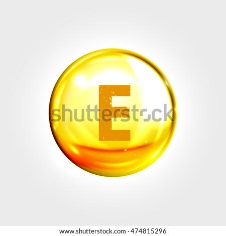 Vitamin E gold icon. Vitamin tocopherol (tocotrienol)  drop pill capsule. Vector shining golden essence droplet. Beauty treatment nutrition skin care design.