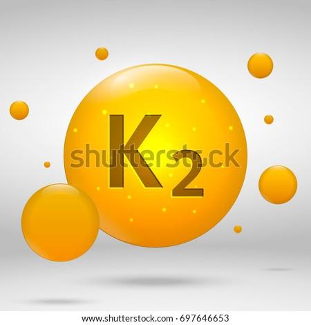 Vitamin K2 gold icon. menaquinone drop pill capsule. Vitamin complex design