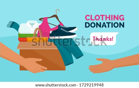 Volunteer holding a donation box with clothes, awareness and charity concept Foto stock ©
