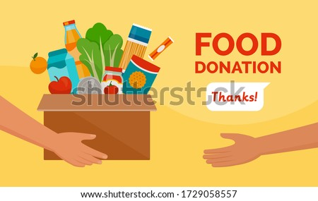 Volunteer holding a donation box with food, awareness and charity concept Foto stock ©