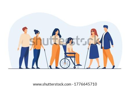 volunteers helping disabled