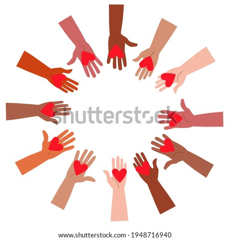Volunteers holding hearts in their hands. The concept of support, love and help. Friendship between people of all countries and nationalities, different ages and skin colors. ストックフォト ©