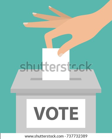 Voting concept. Woman's hand putting paper in the ballot box