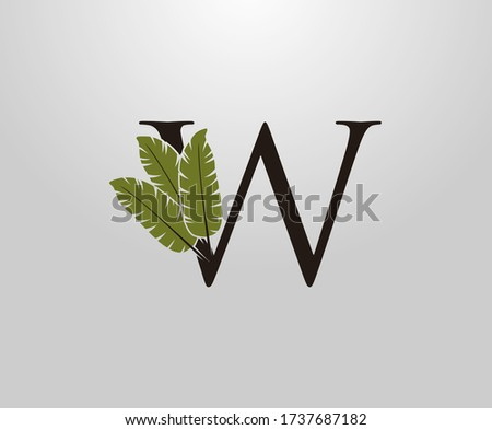 W Letter With Green Banana Leaf, Tropical Alphabet Sign Design Concept. Zdjęcia stock ©