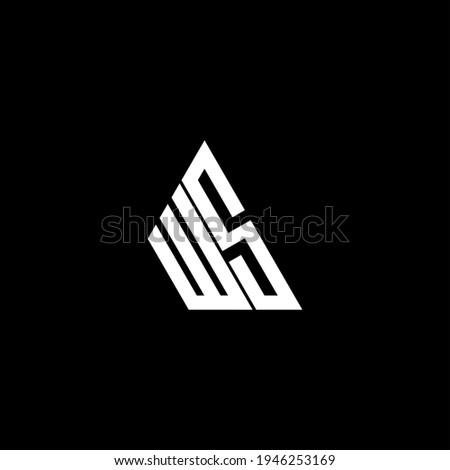 W S letter logo creative design on black color background. WS icon Zdjęcia stock ©