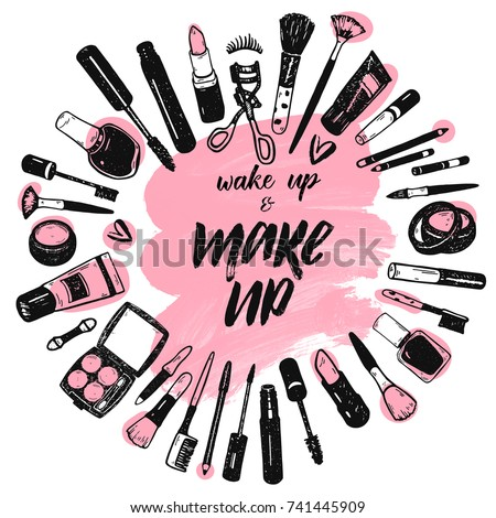 Wake up and make up brush lettering on pink art brush stroke background with cosmetics collection