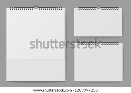 Wall calendar mockup. Blank white desktop office calendar with spiral binder. 3d vector isolated template