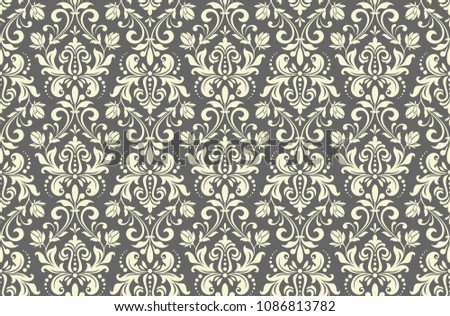Wallpaper in the style of Baroque. A seamless vector background. Grey floral ornament. Graphic pattern for fabric, wallpaper, packaging. Ornate Damask flower ornament