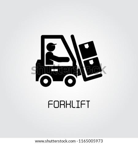warehouse worker driving folk lift